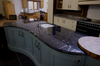 <B>Special shaped island top in Via Lattea Granite with domus edge detail.