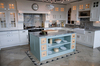 <B>Worktops splashback and Island unit top all manufactured from Piracema Granite.