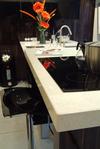 Box edge kitchen worktop in Starlite White form Sinquastone.